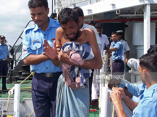 Illegal Bangladeshi migrants are assisted ashore after their rescue at sea by the Indian coastguard in Port Blair on January 8 2009 The Indian Coast...