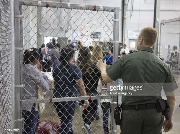 Illegal border crossers, who were detained by U.S. Border Patrol agents, are seen in a jail at the Central Processing Center in McAllen, Texas, USA...
