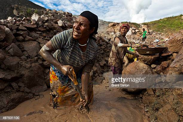 Illegal gold miners prospect at the site of tailing outlet pipe in heavy metal laden waters on the outskirts of the Porgera Joint Venture Mine Papua...