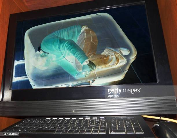 Illegal immigrant detected at an airport on an X-ray machine