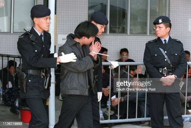156 illegal immigrants 121 men and 35 women aged between 18 and 51 are arrested in the holding area of Tai Lam Marine Police Base after they were...