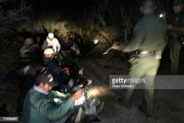 Illegal immigrants are detained by the Eagle Pass Border Patrol just minutes after crossing the border Hundreds of illegal immigrants attempt to...