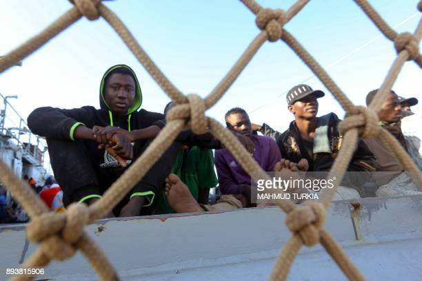 Illegal immigrants arrive at a naval base in Tripoli on December 16 after they were rescued off the coast of Garabulli 60 kilometers east of the...