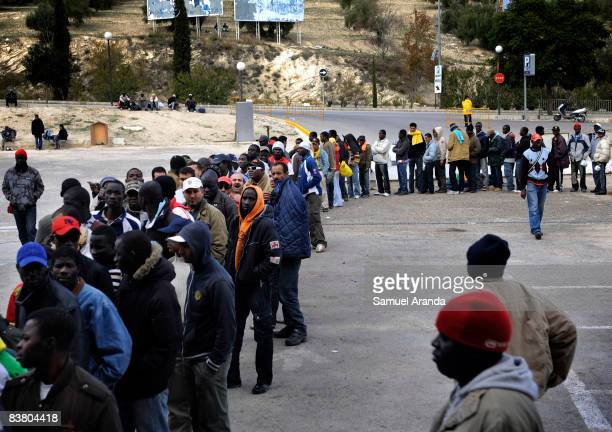 Illegal immigrants que for food at an aid center November 20 2008 in Jaen Spain Jobs such as the yearly olive harvest traditionally undertaken by...