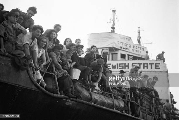 Illegal immigrants wait on the Hagana ship Jewish State in the Haifa port for their deportation to Cyprus by British authorities 30 October 1947...