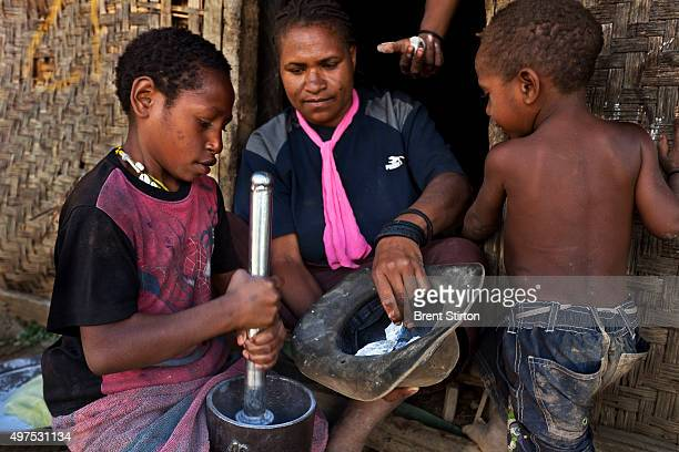 Illegal local miners crush gold bearing ore stolen from processed ore dumps on the outskirts of the Porgera Joint Venture Mine Papua New Guinea...