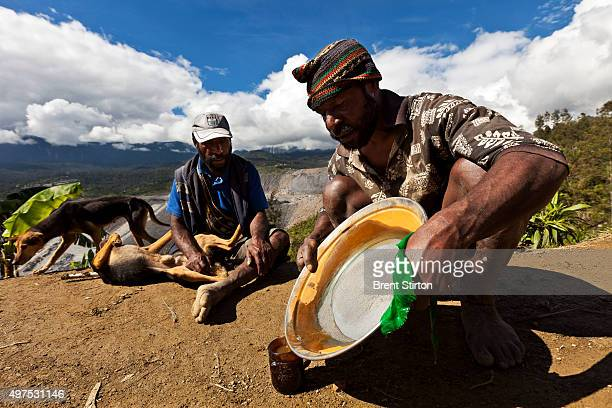 Illegal local miners use mercury to distill gold stolen from processed ore dumps on the outskirts of the Porgera Joint Venture Mine Papua New Guinea...