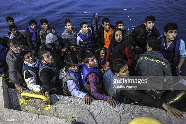 Illegal migrants are seen on a boat after being caught by the Greek Coast Guard teams near Kos Island Greece on June 5 2015 Sixtythree illegal...