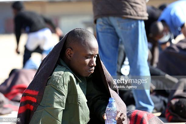 Illegal migrants trying to reach Europe via Libya are seen after they were captured by the coast guards at Tripoli Naval Base in Tripoli Libya on...