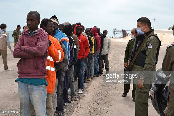 Illegal migrants, who wanted to go to European countries, are seen at the port of Zarsis near Tataouine, Tunis on April 25, 2015 after being rescued...
