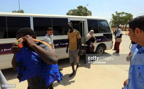 Illegal migrants who were rescued by Libyan coast guards at sea arrive at a migration detention and shelter facility in the capital Tripoli's eastern...