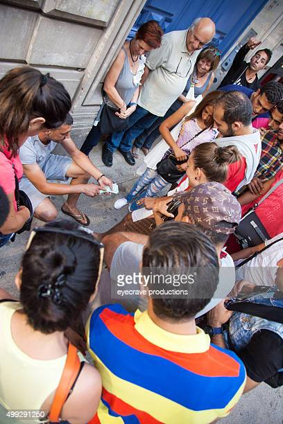 illegal street gambling in paris france - shell game stock photos and pictures