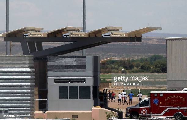 Illegal young migrants play football at a temporary detention centre for illegal underage immigrants in Tornillo Texas US near the MexicoUS border as...