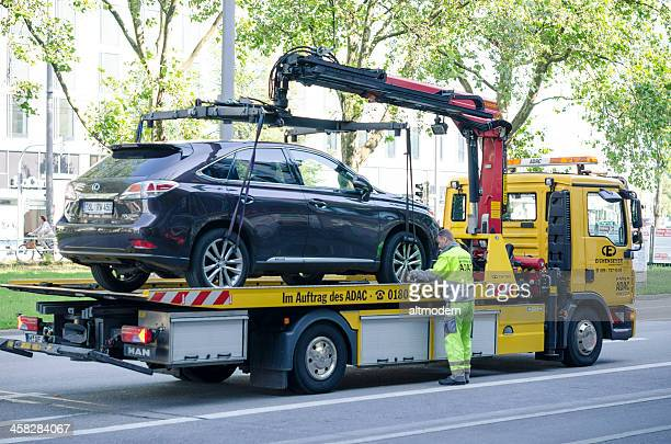 illegally parked - tow truck stock photos and pictures