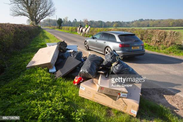 Illegaly dumped fly tipping waste on a roadside verge near Quorn, Leicestershire, UK.