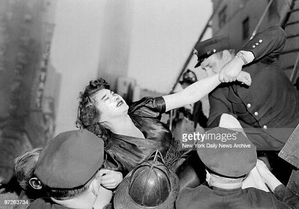 Illiana Laurel a Russian opera singer and former wife of Stan Laurel being carried from burning Radio Center Hotel at 7th Avenue and West 50th Street