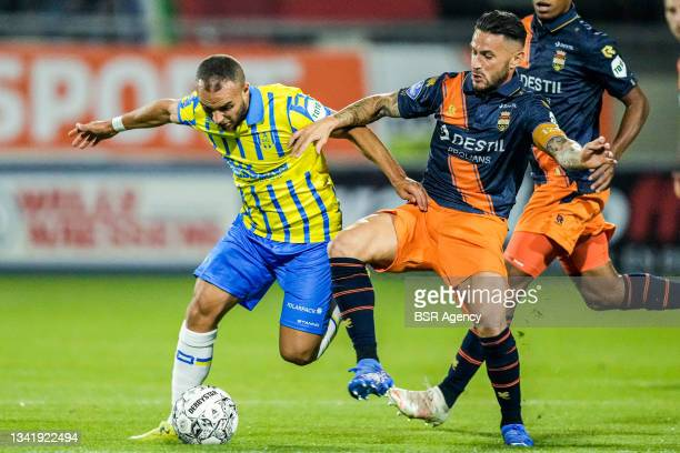 Illiass Bel Hassani of RKC Waalwijk and Paul Llonch of Willem II during the Dutch Eredivisie match between RKC Waalwijk and Willem II at Mandemakers...