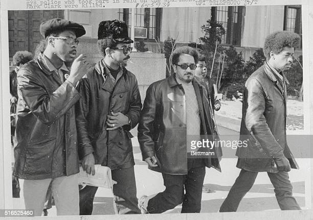 Illinois Black Panther leader Bobby Rush leads group from Criminal Courts building 1/6 during lunch recess in coroner's jury hearing into the deaths...