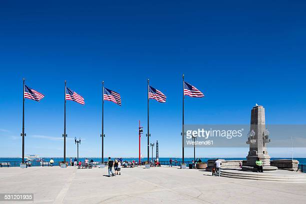 usa, illinois, chicago, flags on navy pier at lake michigan - navy pier stock pictures, royalty-free photos & images