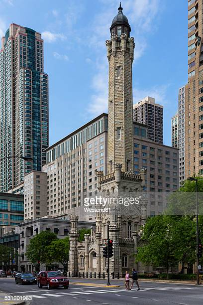 USA, Illinois, Chicago, historic water tower in front of office buildings and John Hancock Center