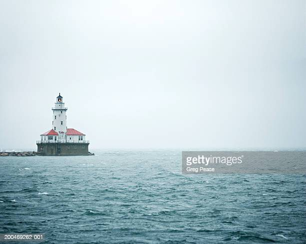 """usa, illinois, chicago, lake michigan, lighthouse - """"greg pease"""" stock pictures, royalty-free photos & images"""