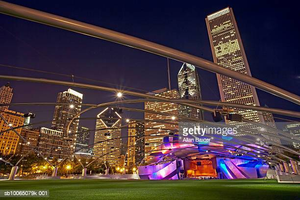 usa, illinois, chicago, millennium park with jay pritzker pavilion, night - jay pritzker pavillion stock photos and pictures
