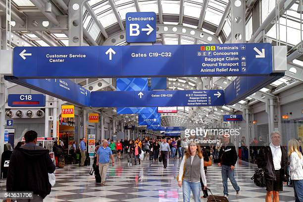 Illinois Chicago O'Hare International Airport ORD concourse gate area terminal passengers luggage sign information directions map