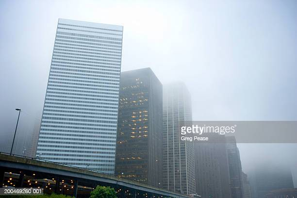 """usa, illinois, chicago, skyscrapers in fog, low angle view - """"greg pease"""" stock pictures, royalty-free photos & images"""
