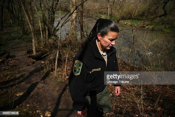 Illinois Conservation Police Officer Holly Vadbunker patrols near the Rock River and Kankakee River State Park in Bourbonnais, Ill. Vadbunker was a...
