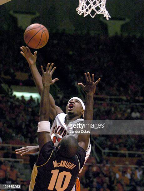 Illinois' Dee Brown goes over Brandon McKnight for 2 of his 14 points in the first half of Purdue's 5854 win over Illinois Champaign Illinois January...
