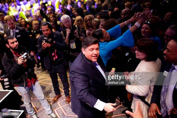 Illinois Democratic candidate for Governor JB Pritzker center greets people during his primary election night victory speech on March 20 2018 in...
