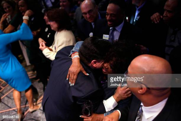 Illinois Democratic candidate for Governor JB Pritzker center greets a woman with a hug during his primary election night victory speech on March 20...