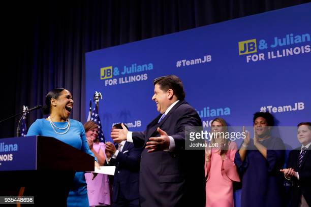 Illinois Democratic candidate for Governor JB Pritzker gesture towards his Lieutenant Governor pick Juliana Stratton for a hug during his primary...