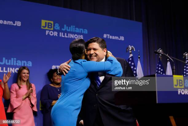 Illinois Democratic candidate for Governor JB Pritzker receives a hug from his Lieutenant Governor pick Juliana Stratton during his primary election...