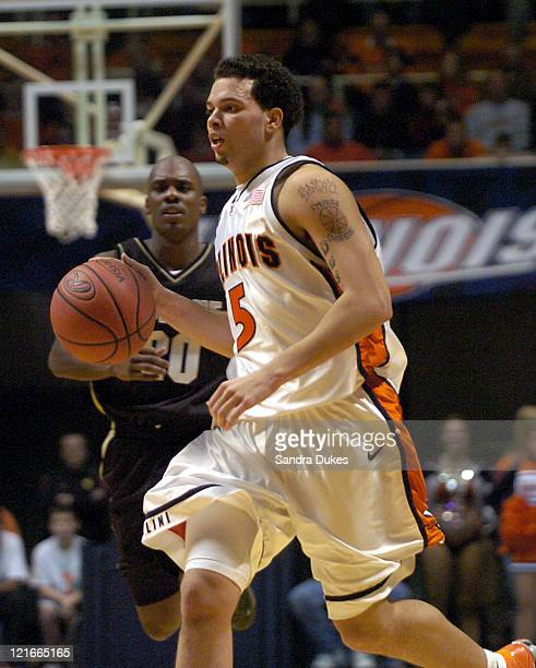 Illinois' Deron Williams brings the ball up court past Kenneth Lowe in the first half of Purdue's 5854 win Champaign Illinois January 10 2004