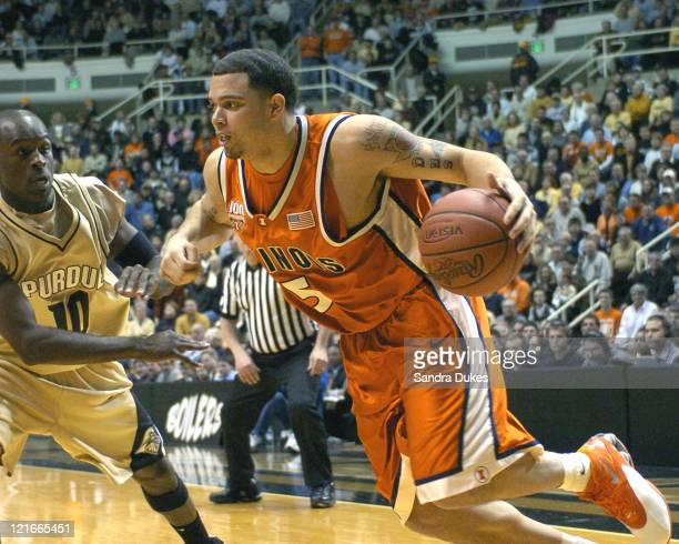 Illinois' Deron Williams drives past Brandon McKnight in the first half of a game won by Illinois 6859 at Mackey Arena in West Lafayette Indiana on...