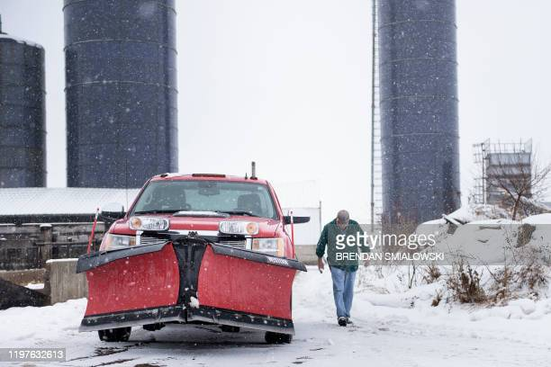 Illinois farmer Brian Duncan walks to a truck near silos where he feeds cattle January 25 in Polo Illinois America is in flux Once stable jobs have...
