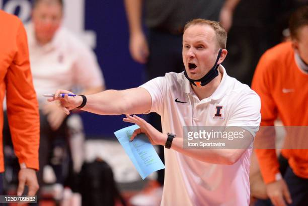 Illinois Fighting Illini assistant coach Stephen Gentry signals to players during the Big Ten Conference college basketball game between the Penn...