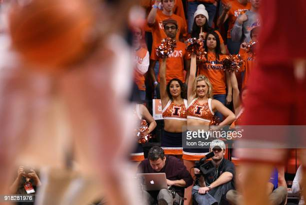 Illinois Fighting Illini cheerleaders look on as a player shoots a free throw during the Big Ten Conference college basketball game between the...