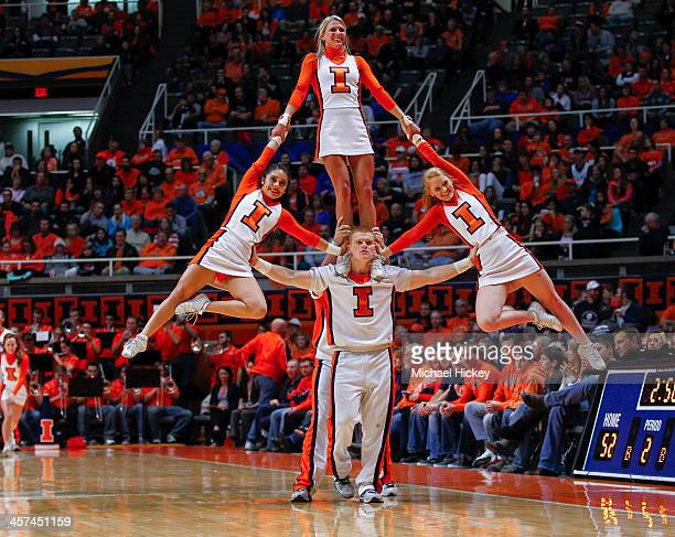 Illinois Fighting Illini cheerleaders seen during a break in the game against the IPFW Mastodons at Assembly Hall on November 29 2013 in Champaign...