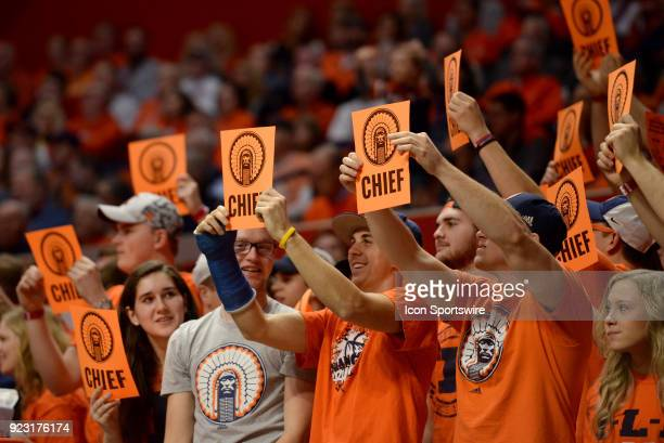 Illinois Fighting Illini fans hold up signs in support of the Chief logo during the Big Ten Conference college basketball game between the Purdue...