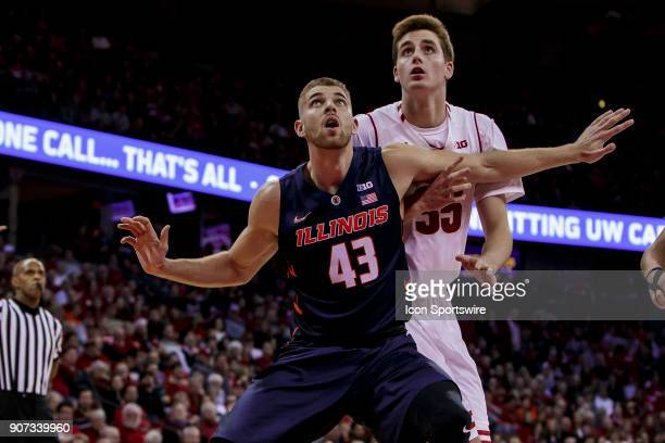 Illinois Fighting Illini forward Michael Finke boxes out Wisconsin Badger forward Nate Reuvers on a free throw attempt during an college basketball...