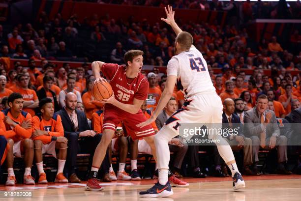 Illinois Fighting Illini forward Michael Finke guards Wisconsin Badgers forward Nate Reuvers during the Big Ten Conference college basketball game...
