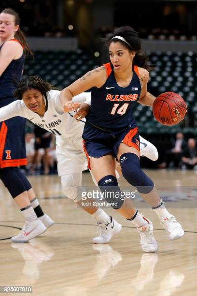 INDIANAPOLIS IN Illinois Fighting Illini freshman Addaya Moore drives past Penn State Nittany Lions guard Teniya Page during the game between the...