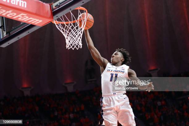 Illinois Fighting Illini guard Ayo Dosunmu dunks the ball during the Big Ten Conference college basketball game between the Rutgers Scarlet Knights...
