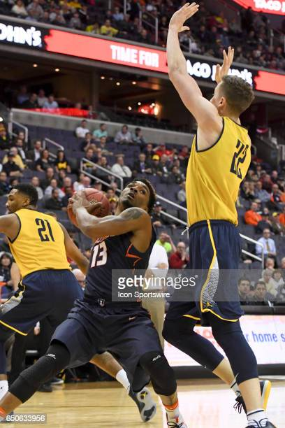 Illinois Fighting Illini guard Tracy Abrams is fouled by Michigan Wolverines guard Duncan Robinson in the second round of the Big 10 Tournament game...