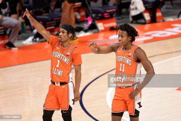 Illinois Fighting Illini guard Trent Frazier and Illinois Fighting Illini guard Ayo Dosunmu motion to teammates during the Big Ten Conference college...