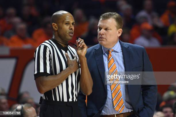 Illinois Fighting Illini Head Coach Brad Underwood talks with Big Ten Official Steve McJunkins during a break in the action in the Big Ten Conference...