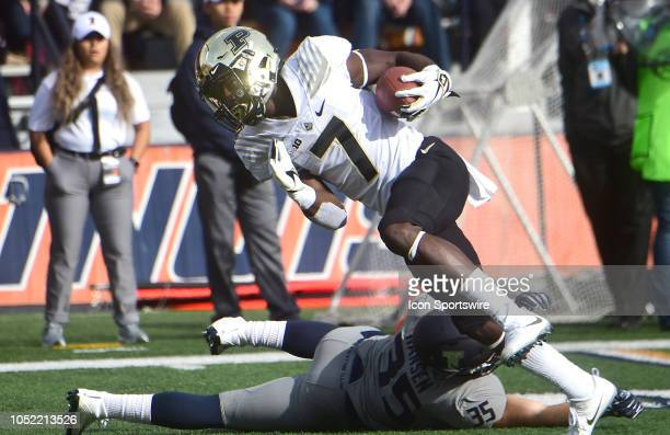 Illinois Fighting Illini linebacker Jake Hansen trips up Purdue Boilermakerswide receiver Isaac Zico during a Big Ten Conference college football...
