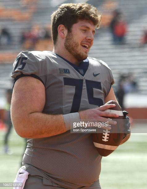 Illinois Fighting Illini offensive lineman Kurt Gavin warms up before a Big Ten Conference college football game between the Purdue Boilermakers and...